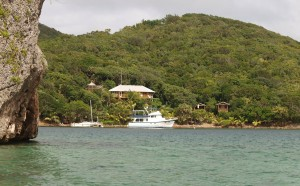 view of home from water with anchored boat