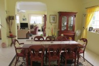 formal diing room table with yellow walls