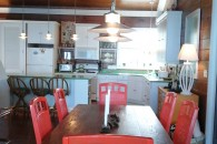 kithen dining table to the kitchen with red chairs
