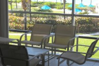 image of chairs and table in the screened porch