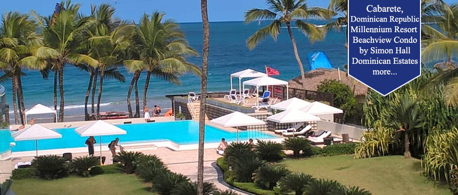 View of pool to ocean with cabanas on north coast