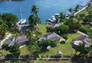 aerial view behind property with bay in front
