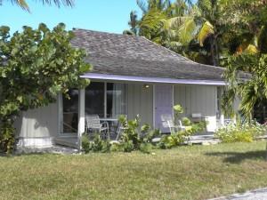 off-cener to the left of the purple door villa