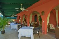 covered patio with ceiling fans
